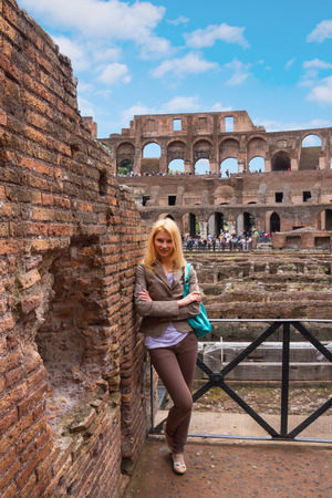 excursions: Attractive girl on excursions at the Colosseum. Rome, Italy Stock Photo