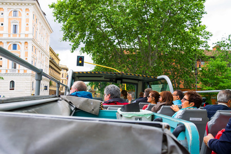 ROME, ITALY - MAY 03, 2014: Tourists visiting the attractions of the tour bus in Rome, Italy