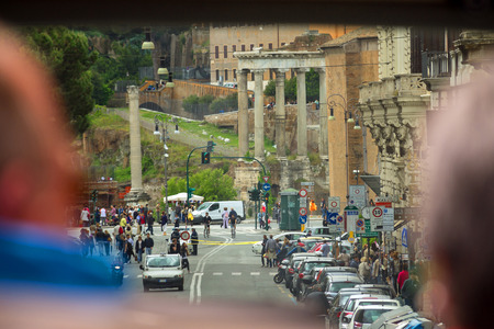 ROME, ITALY - MAY 03, 2014: Tourists  see the sights of Rome from the window of a tourist bus, Italy