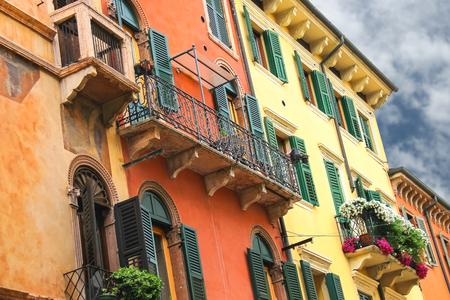Flowers on the balcony of the beautiful Italian home photo