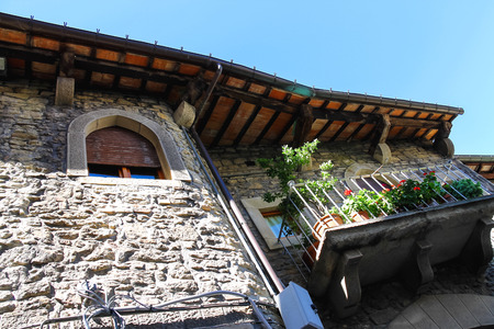 Picturesque Italian house with flowers on the balconies