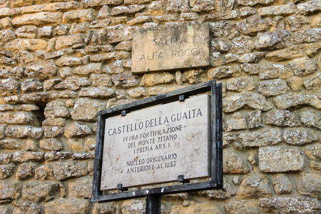 memorable: SAN MARINO. SAN MARINO REPUBLIC - AUGUST 08, 2014: Memorable plaque near the castle in San Marino. The text states: Castello della Guaita. first fortification of Mount Titan. original core prior to 1253