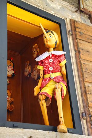 pinocchio: SAN MARINO. SAN MARINO REPUBLIC - AUGUST 08, 2014:  Pinocchio in the window  building store of wooden toys in San Marino. The Republic of San Marino Editorial