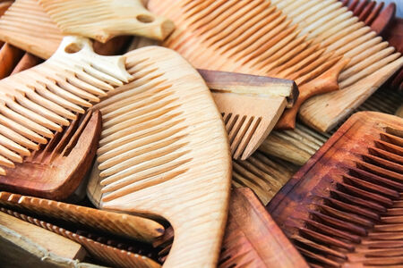 Lots of hand made wooden comb closeup photo