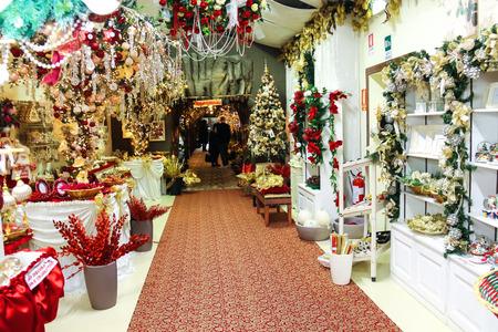 Taneto, Italy - December 27, 2014: Buyers in Great Cristmas market Villaggio di Babbo Natale in the garden center Mondoverde. Taneto, Italy