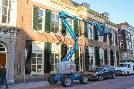 car hoist: Den Bosch, Netherlands - January 17, 2015: Car Tower - hoist works on the street in  Dutch city of Den Bosch