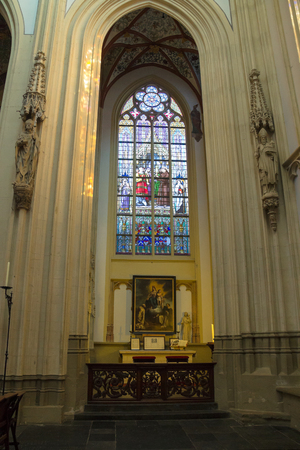 den: Den Bosch, Netherlands - January 17, 2015: Stained glass and  picture in the cathedral  the Dutch city of Den Bosch