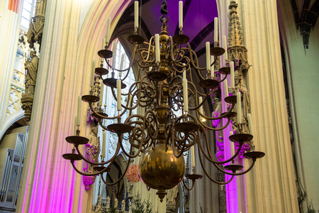 den: Chandelier with candles in the cathedral Dutch city of Den Bosch