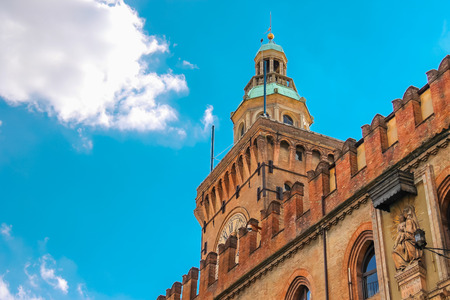 crenellated tower: Clock Tower and facade of the Palazzo Comunale in Bologna. Italy