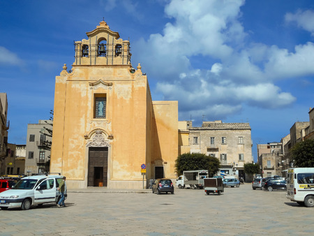 levanzo: Favignana, Sicily, Italy - March 10, 2015: People and cars near the church  of the Piazza Matrice