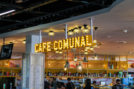 schiphol: Amsterdam Schiphol, Netherlands - April 18, 2015: Passengers relax in the cafe Comunal at the airport Amsterdam Schiphol, Netherlands