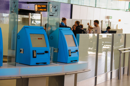 schiphol: Amsterdam Schiphol, Netherlands - April 18, 2015:Transit passengers are registered in the airport terminal. Amsterdam Schiphol, Netherlands