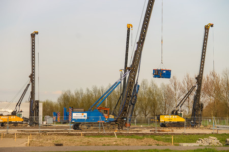 pile engine: Meerkerk, municipality Zederik, Netherlands - April 13, 2015: Machinery for pile driving are on site on the outskirts of Meerkerk, Netherlands Editorial