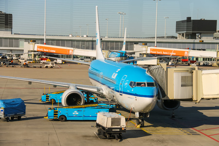 schiphol: Amsterdam Schiphol, Netherlands - April 18, 2015: Maintenance of aircraft on the airfield at the airport Amsterdam Schiphol, Netherlands Editorial