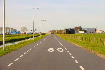 hause: Meerkerk, municipality Zederik, Netherlands - April 13, 2015: The road on the outskirts of Meerkerk, Netherlands