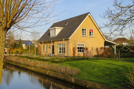 dutch canal house: Residential building with a beautiful garden in Meerkerk, Netherlands