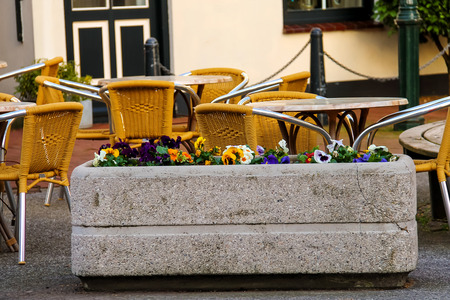 Flowers decorate outdoor café in the Dutch town Stock Photo