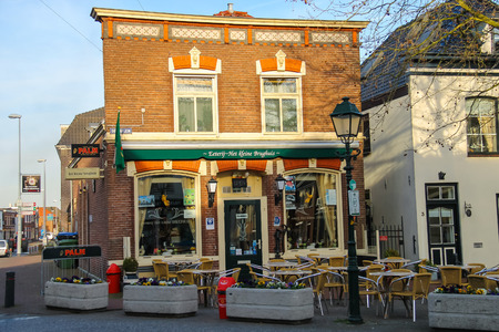 gorinchem: Meerkerk, municipality Zederik, Netherlands - April 13, 2015: Tables outdoor restaurant Eeterij Het Kleine Brughuis in Dutch city Meerkerk, Netherlands