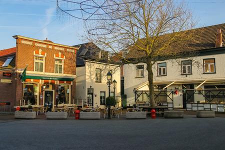 Meerkerk, municipality Zederik, Netherlands - April 13, 2015: Tables outdoor restaurant Eeterij Het Kleine Brughuis in Dutch city Meerkerk, Netherlands