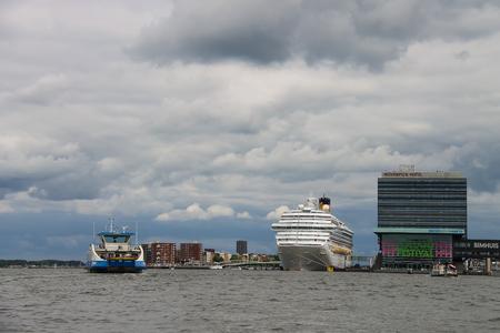 fortuna: Amsterdam, Netherlands - June 20, 2015: Cruise ship Costa Fortuna stands in the passenger terminal of Amsterdam