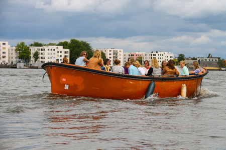 cruiseboat: Amsterdam, Netherlands - June 20, 2015: People in the boat on tours of the canals of Amsterdam