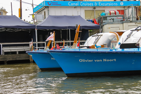 cruiseboat: Amsterdam, Netherlands - June 20, 2015: Excursion ships are near the pier on the waterfront in Amsterdam