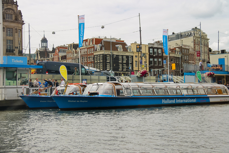 Amsterdam, Netherlands - June 20, 2015: People on the dock landing on river cruise ships, Amsterdam, Netherlands Editorial