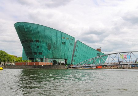 nemo: Amsterdam, Netherlands - June 20, 2015: The Nemo Museum,the largest science childrens museum and center of tourism in Amsterdam.