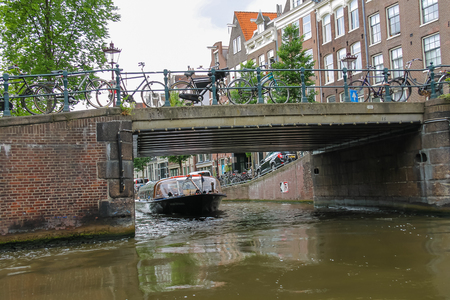 Amsterdam, Netherlands - June 20, 2015: Boat on tours of the canals of Amsterdam
