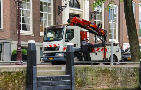 hoist: Amsterdam, Netherlands - June 20, 2015: Car Tower - hoist works on the street in Amsterdam Editorial