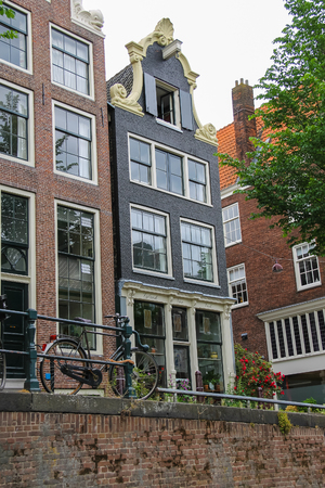 gabled house: Amsterdam, Netherlands - June 20, 2015: Old buildings on the waterfront canal in Amsterdam Editorial