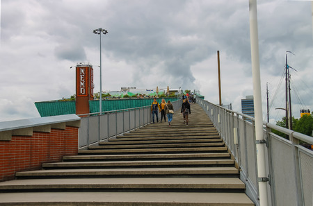 nemo: Amsterdam, Netherlands - June 20, 2015: People on the stairs to the roof of the museum Nemo in Amsterdam Editorial