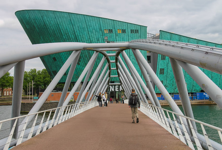 nemo: Amsterdam, Netherlands - June 20, 2015: People on the bridge to the Nemo museum in Amsterdam