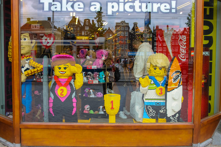 artists dummy: Amsterdam, Netherlands - June 20, 2015: Shop window of toys in Amsterdam. Netherlands
