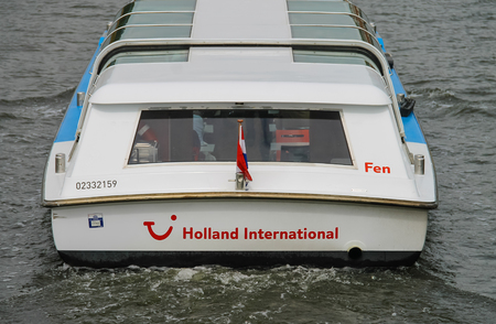 cruiseboat: Amsterdam, Netherlands - June 20, 2015: Boats on a canal in Amsterdam. Netherlands Editorial