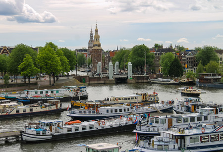 cruiseboat: Amsterdam, Netherlands - June 20, 2015: View of the port from the observation deck on the roof of museum Nemo in Amsterdam