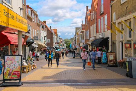 dutch girl: Zandvoort, the Netherlands - June 20, 2015: Tourists wakling on the popular shop street Kerkstraat. View from the Boulevard de Favauge. Zandvoort aan Zee is a major sea resort of North sea
