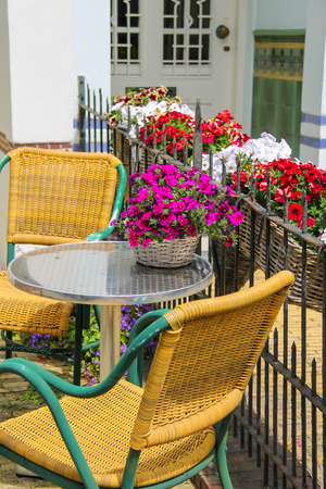 small table: Small table and two chairs on a  fenced terrace near the building. Zandvoort, the Netherlands