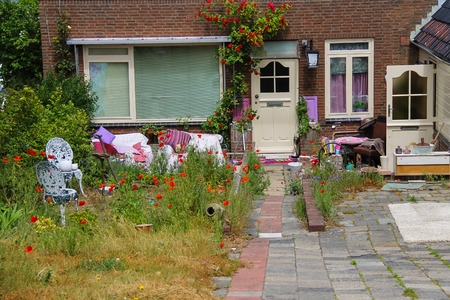 traditional plants: Street view of traditional house decorated with plants and furniture in Zandvoort, the Netherlands