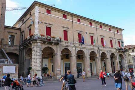 rimini: Rimini, Italy - August 16, 2014: Tourists walking near Rimini City Hall on Cavour square in Rimini, Italy Editorial