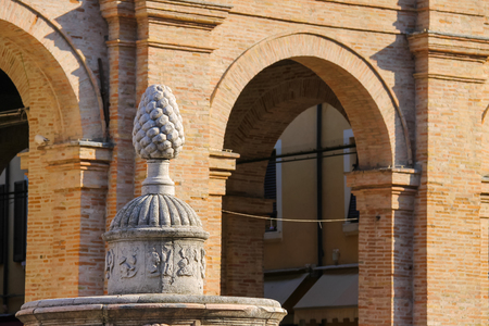 cavour: Ancient fountain with pinecone on Cavour square in Rimini, Italy