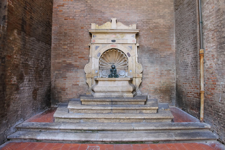 cavour: Old fountain with small boy on a dolphin on Cavour square in Rimini, Italy
