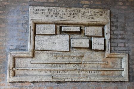 cavour: Old sign on the wall of ancient building on Cavour square in Rimini, Italy