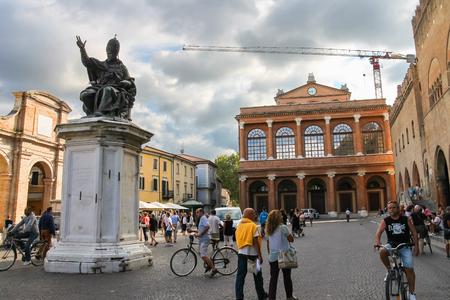 cavour: Rimini, Italy - August 16, 2014: Tourists walking near the ancient buildings and statue of Pope Paul V on Cavour square in Rimini, Italy Editorial