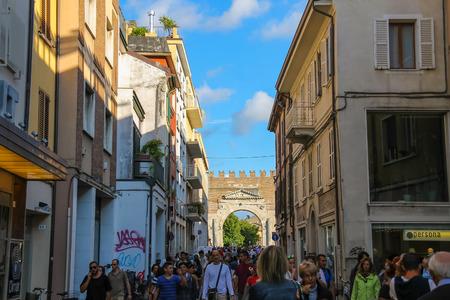 martiri: Rimini, Italy - August 16, 2014: Tourists walking from Tre Martiri square (Piazza Tre Martiri) to Arch of Augustus (Arco di Augusto).