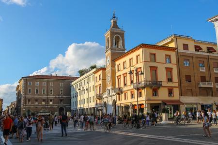 martiri: Rimini, Italy - August 16, 2014: Tourists walking on Tre Martiri square (Piazza Tre Martiri) in the centre of Rimini, Italy