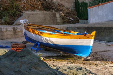 tyrrhenian: Tricolor boat on the beach of the Tyrrhenian Sea on Elba Island, Italy