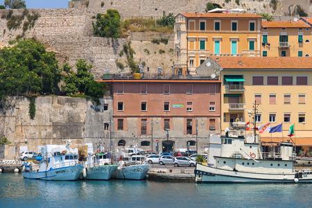 berth: Portoferraio, Italy - June 30, 2015: Passengers boats at berth in Portoferraio. It is the largest city and main harbour on Elba island. Editorial