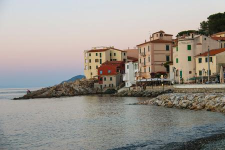 tyrrhenian: Marciana Marina, Italy - July 01, 2015: Empty beach on the coast of the Tyrrhenian Sea, Elba Island. Marciana Marina is  one of the most important towns of Elba Island in region of Tuscany, Italy