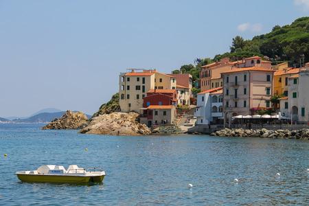 tyrrhenian: Marciana Marina, Italy - July 01, 2015: Catamaran near the coast of the Tyrrhenian Sea, Elba Island. Marciana Marina is  one of the most important towns of Elba Island in region of Tuscany, Italy Editorial